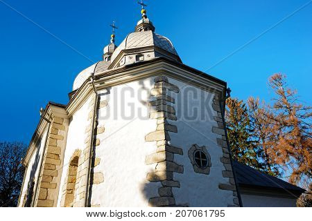 View from below on the centuries-old cloistered church.