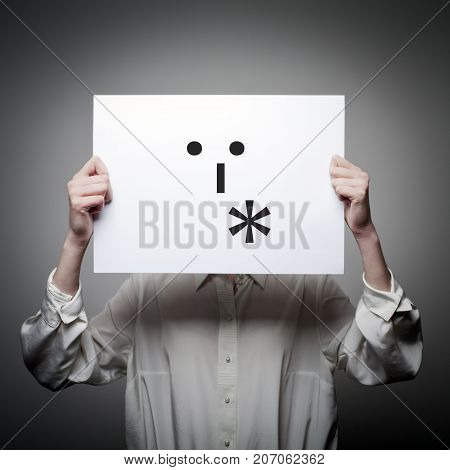 Woman is holding white paper with smile. Kiss and love concept.