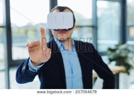 Sensory technology. Selective focus of a finger pressed to the sensory panel while wearing 3d glasses
