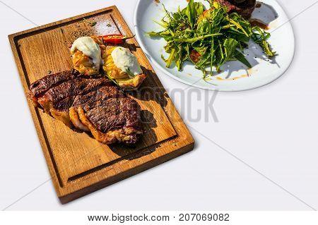 Grilled T-bone Steak On Cutting Board