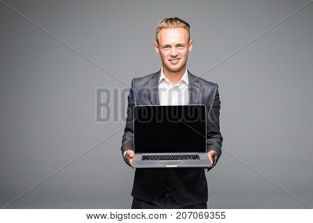 Man Hand On Laptop With Blank Screen Monitor For Text. Businessman Showing Laptop With Blank Screen.