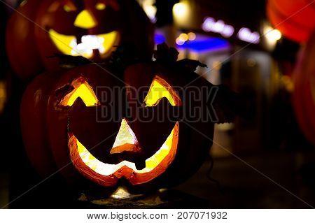 Scary Jack O Lantern Halloween Pumpkin on black or dark background with copy space.