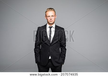 Picture Of A Young Business Man Looking Up While Holding Both Hands In His Pocket.