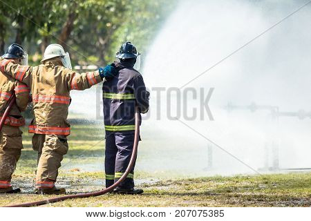 Firefighters are training for fighting with fire from gas.