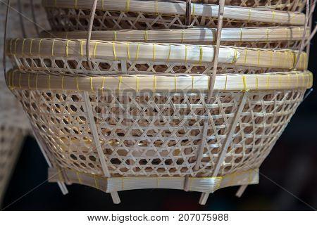 Beautiful handicraft woven bamboo basket thai style.