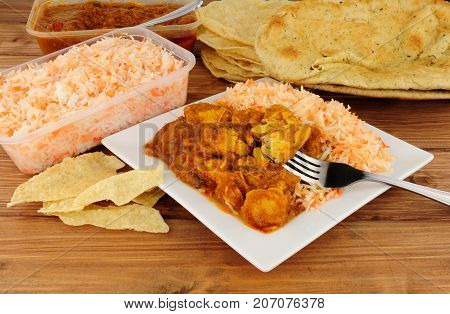 Indian curry take away meal with poppadoms and nan bread