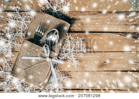 Christmas Table Place Setting And Silverware, Snowflakes With Snow Winter On Table Wooden Background