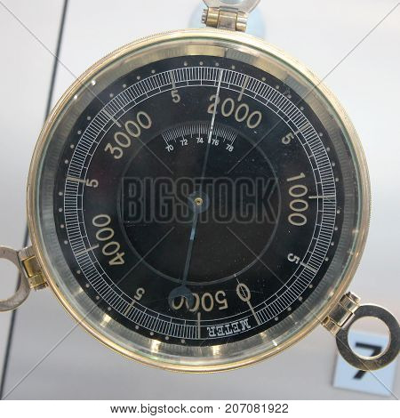 Old Vintage German Altimeter barometer with based on a white background isolated 0-5000 meter.