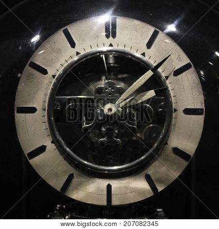 Old vintage antique clock on black background.