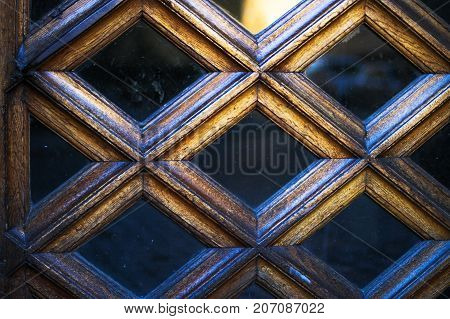 The surface of the diamond-shaped wooden doors with glass inserts - unique texture