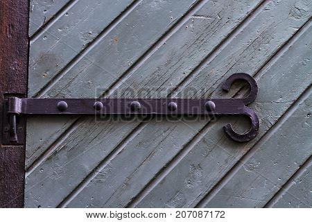 Texture medieval wooden door with metal hinges
