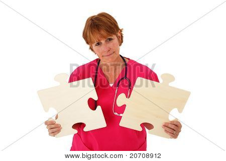Nurse Holding Puzzle Pieces
