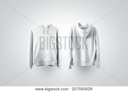 Blank white sweatshirt mockup set, front and back side view. Empty sweat shirt mock up on rack. Clear cotton hoody template. Plain textile hoodie. Loose overall jumper dress for printing.