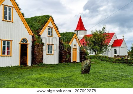 Farm Museum in Glaumbaer - Iceland. Picturesque village of old houses covered with turf and grass.