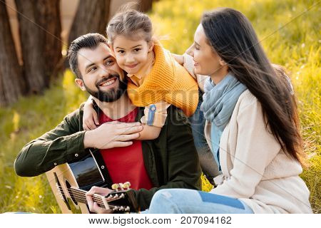 Child Hugging Father In Park