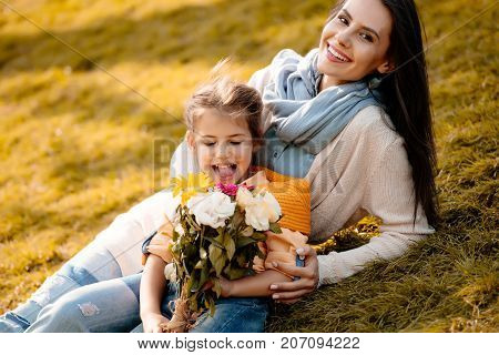 Daughter And Mother With Bouquet