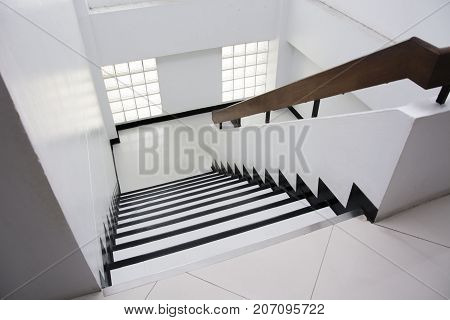 Clean white stairway in the office building.
