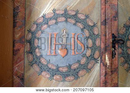 VARAZDIN, CROATIA - JULY 09: IHS sign on altar in cahedral of Assumption in Varazdin, Croatia on July 09, 2016.