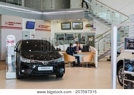 Russia, Kirov - August 21, 2017: Showroom and car of dealership Toyota in Kirov city in 2016