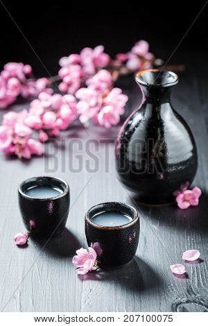 Traditional And Delicate Sake With Blooming Flowers