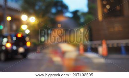 Blurry Image Of City Street Life.