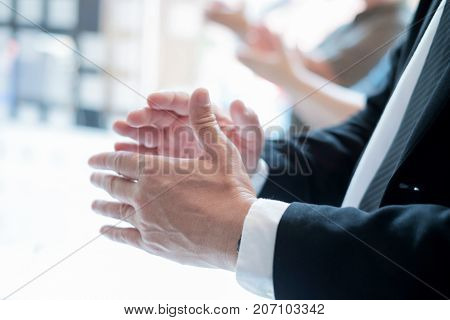 Business Partners Clapping Hands After Business Seminar.