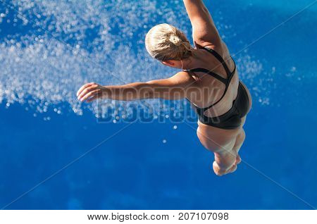 Falling To The Water, Blue Background, Selective Focus, One Person Only