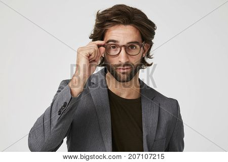 Scrutiny guy in grey suit jacket t and glasses portrait