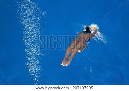 Water Contact, Blue Background, Selective Focus, One Person Only