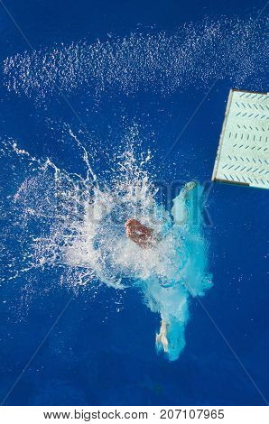 Springboard Dive, Blue Background, Selective Focus, One Person Only