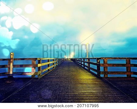 Autumn Misty Morning On Wooden Pier Above Sea. Depression, Dark  Atmosphere. Touristic Mole In Mist