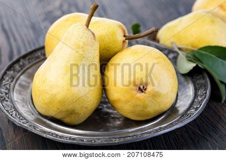 Fresh pears on a wooden kitchen table