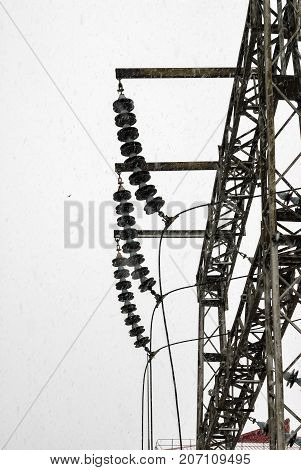 Electric power equipment, high pressure ceramic and metal stents, power grid and power lines. Snowy weather