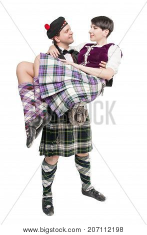 Man In Traditioanl Scottish Costume Holding Woman On Hands