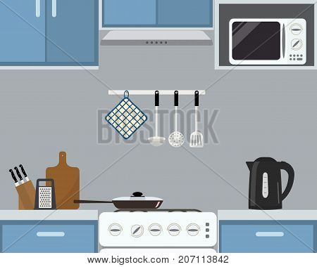 Fragment of kitchen interior in a blue color. There is a frying pan on the stove, a black kettle, a microwave and other objects in the picture. Vector flat illustration