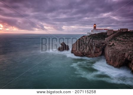 Lighthouse Cabo Sao Vicente before the storm and dramatic sky. Portugal