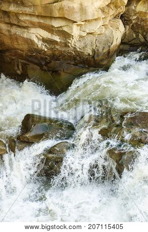 Stormy stream of a mountain river. Stones in the water