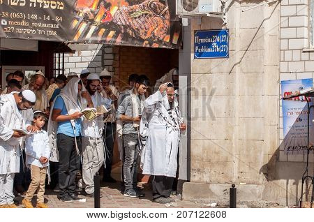 Prayer. Hasids pilgrims in traditional clothes. Tallith - jewish prayer shawl. Uman Ukraine - 21 September 2017: Rosh Hashanah Jewish New Year.