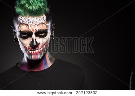 Portrait of man with mystical makeup. Face art concept, professional makeup for Halloween party.