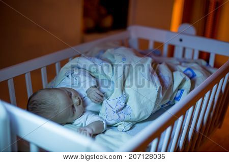 Adorable Newborn Baby Boy, Sleeping In Crib At Night