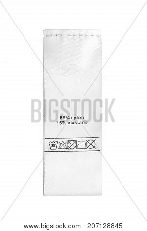 Fabric composition and washing instructions clothes label on white background