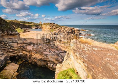 Rocky Cove and Beach at Rumbling Kern, near Howick on the Northumberland coastline, lies a small beach and cove sheltered by small cliffs