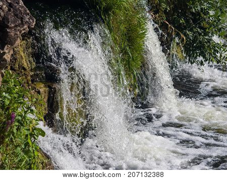 Waterfall Ventas Rumba on river Venta at Kuldiga Latvia selective focus shallow DOF.