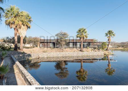 GROSS BARMEN NAMIBIA - JULY 4 2017: The dam with the restaurant in the back at Gross Barmen near Okahandja in the Otjozondjupa Region of Namibia