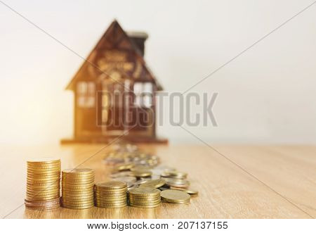 Toy house with money stack step growing money Concept finance business and saving.