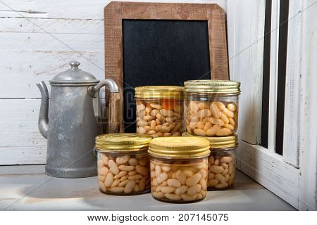 jars of delicious white beans near the window