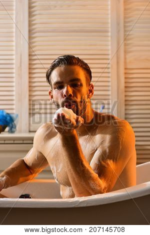 Sex And Erotica Concept: Macho Blowing Foam From Palm