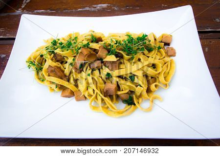 Italian dish: Fresh handmade tagliatelle pasta with porcini mushrooms