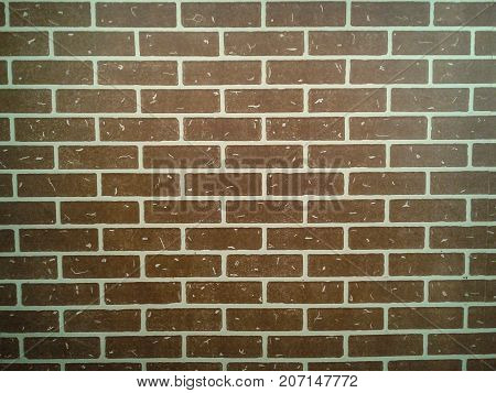 Texture of a brown brick wall with chinks