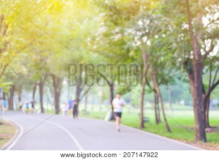 Blurred background of people activities in park with bokeh spring and summer season
